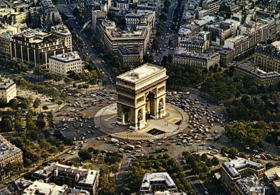 Arc de Triomphe, Paris, France. Twelve avenues converge to form up to 10 lanes of traffic going in an endless circle. Though… | Arc de triomphe, City photo, Aerial