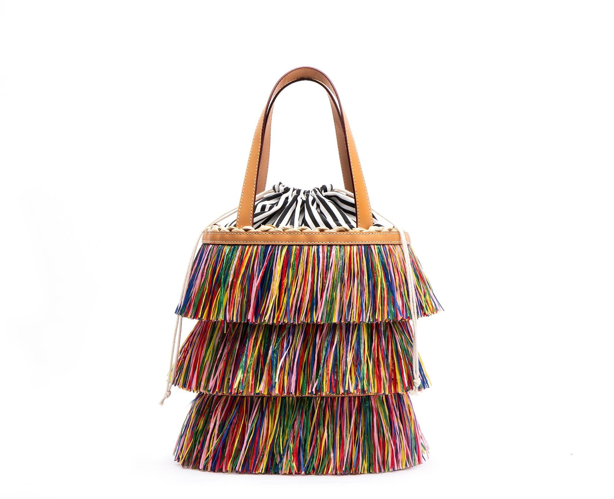 f13d83fdb9 Large Fringe Bucket Bag. Raffia fringe. Designed in New York by Kate  Valentine Spade.
