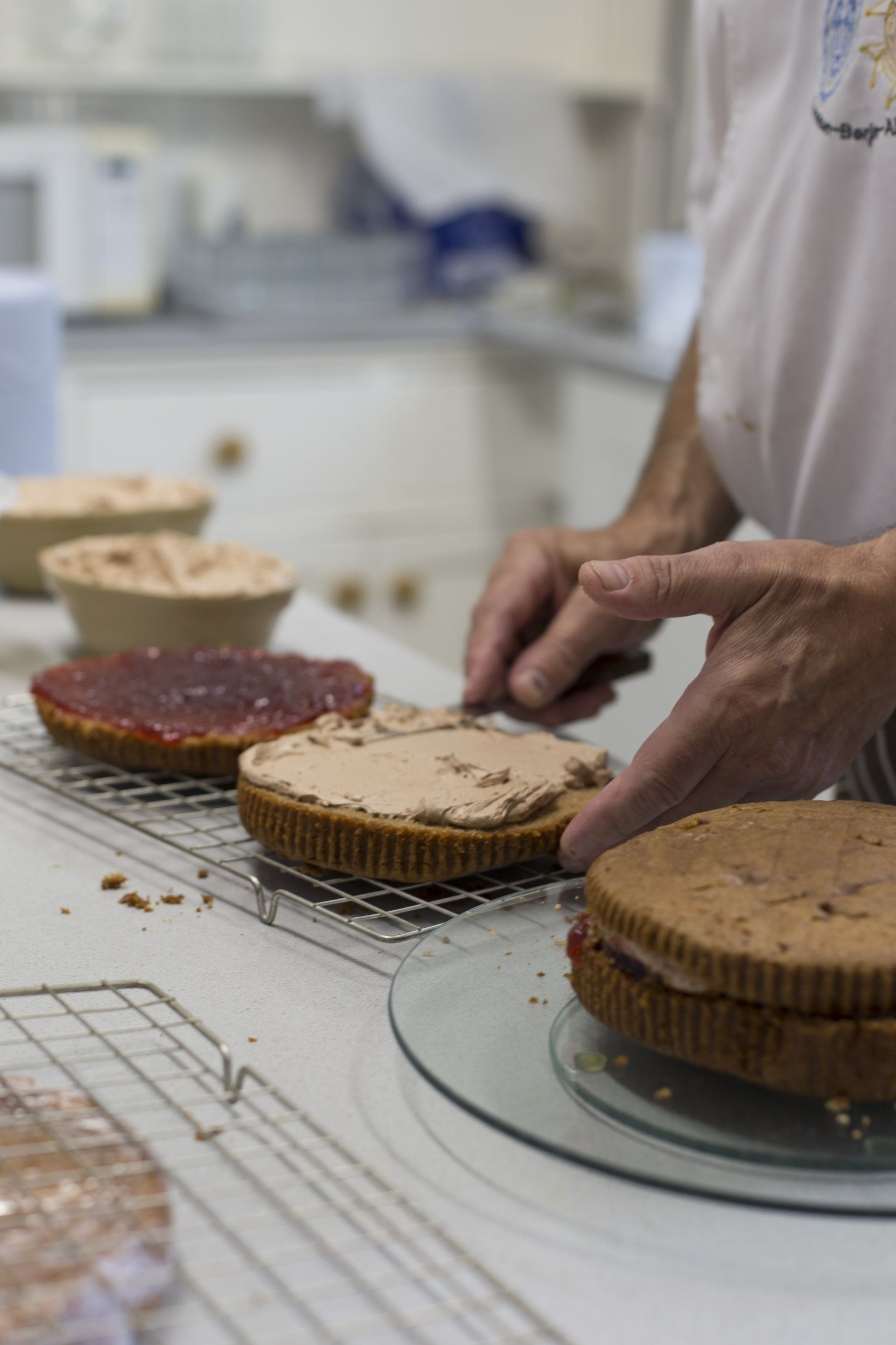 Cake assembly line. Our dedicated team puts together our delicious sweet treats #vegetarian #treat #cake #afternoontea