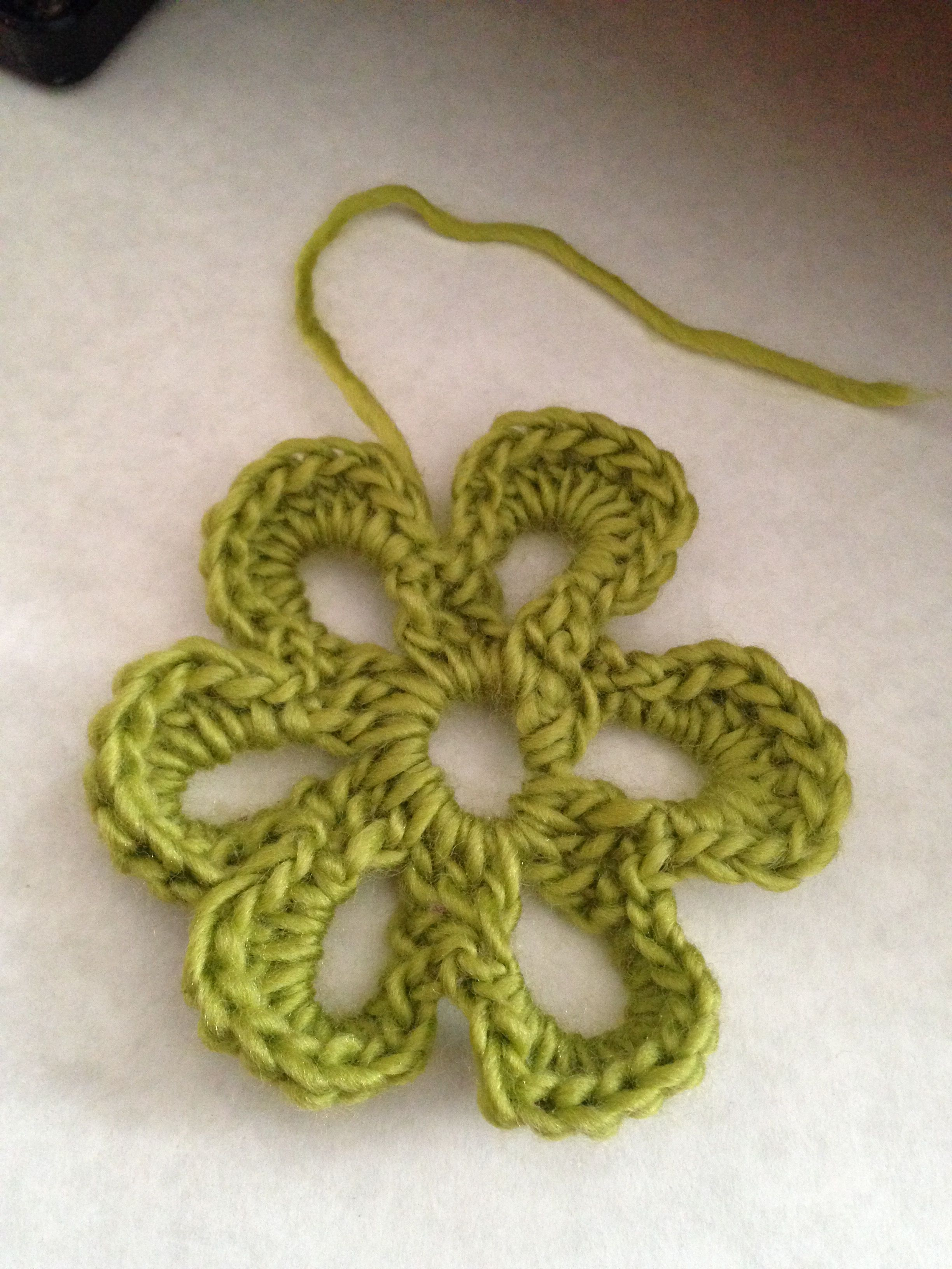 Another flower from a pattern I found on the Internet. Obviously I like to use green yarn. :-)