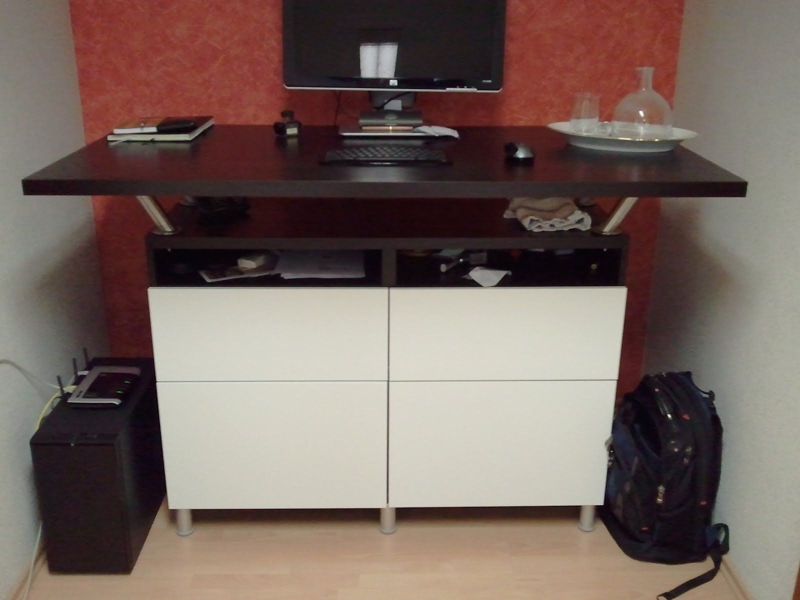 Beautiful standing desk made from Besta cabinets and Capita legs and  brackets, from Simon,