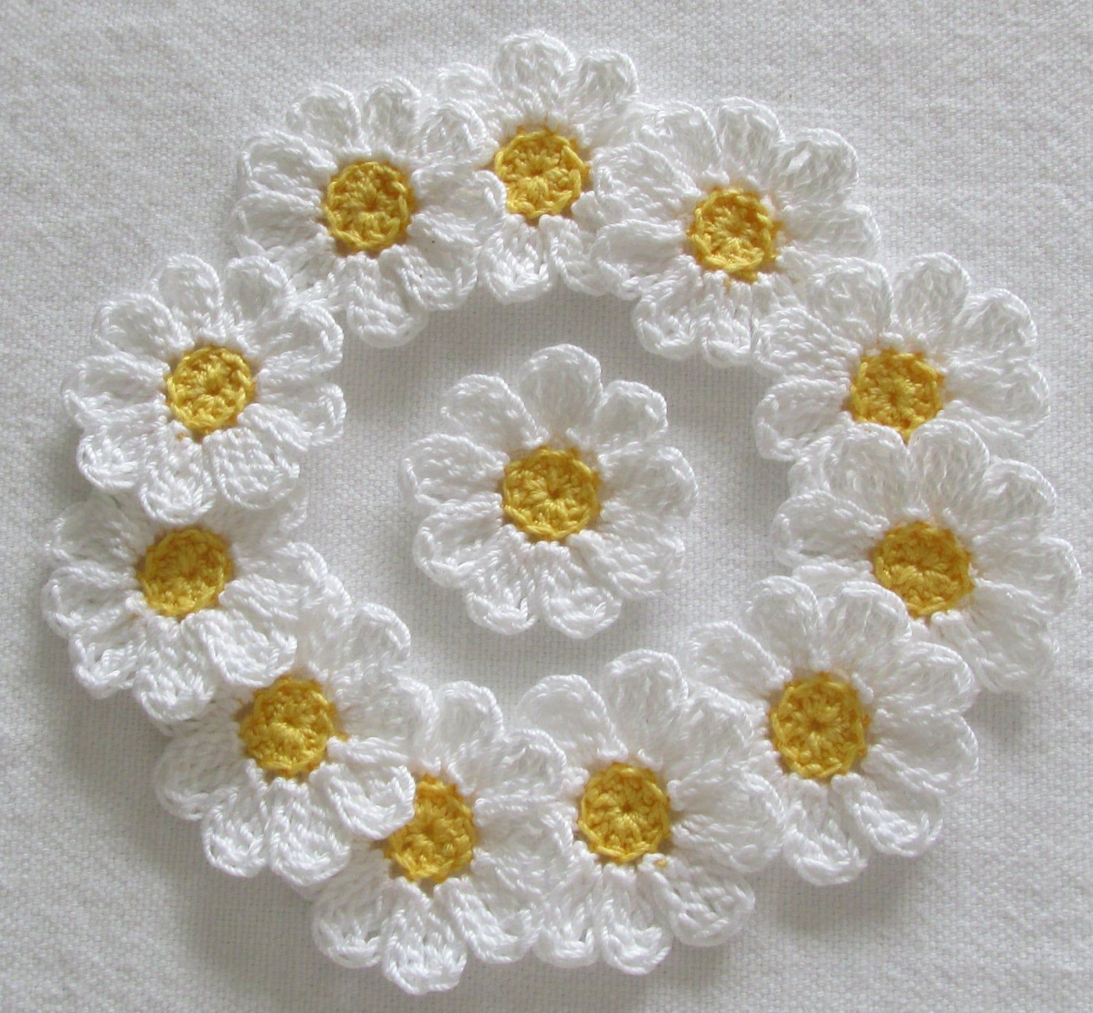 Lot of small crochet flowers in cotton