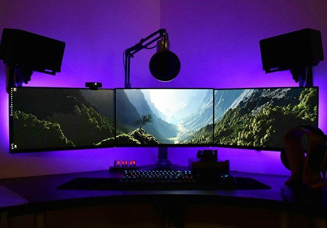 Immersive gaming setup with three monitors, a mechanical