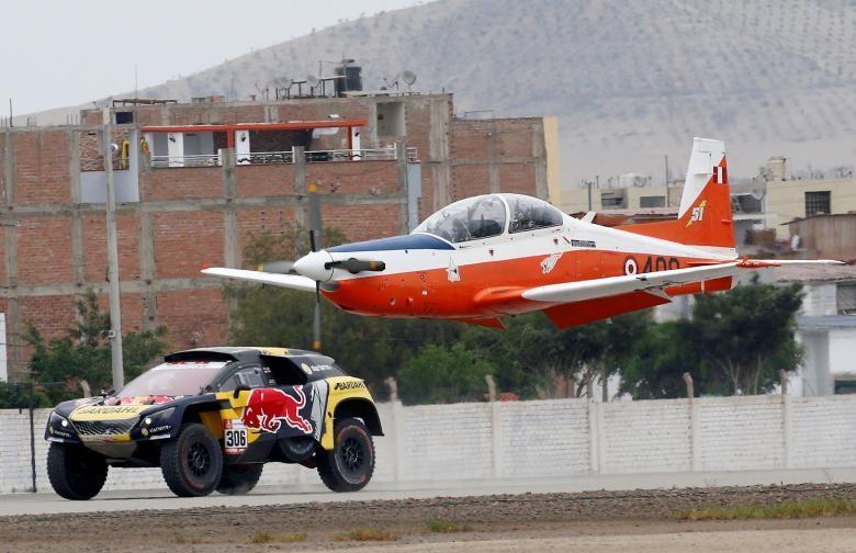 PH Sport's driver Sebastian Loeb races against an airplane