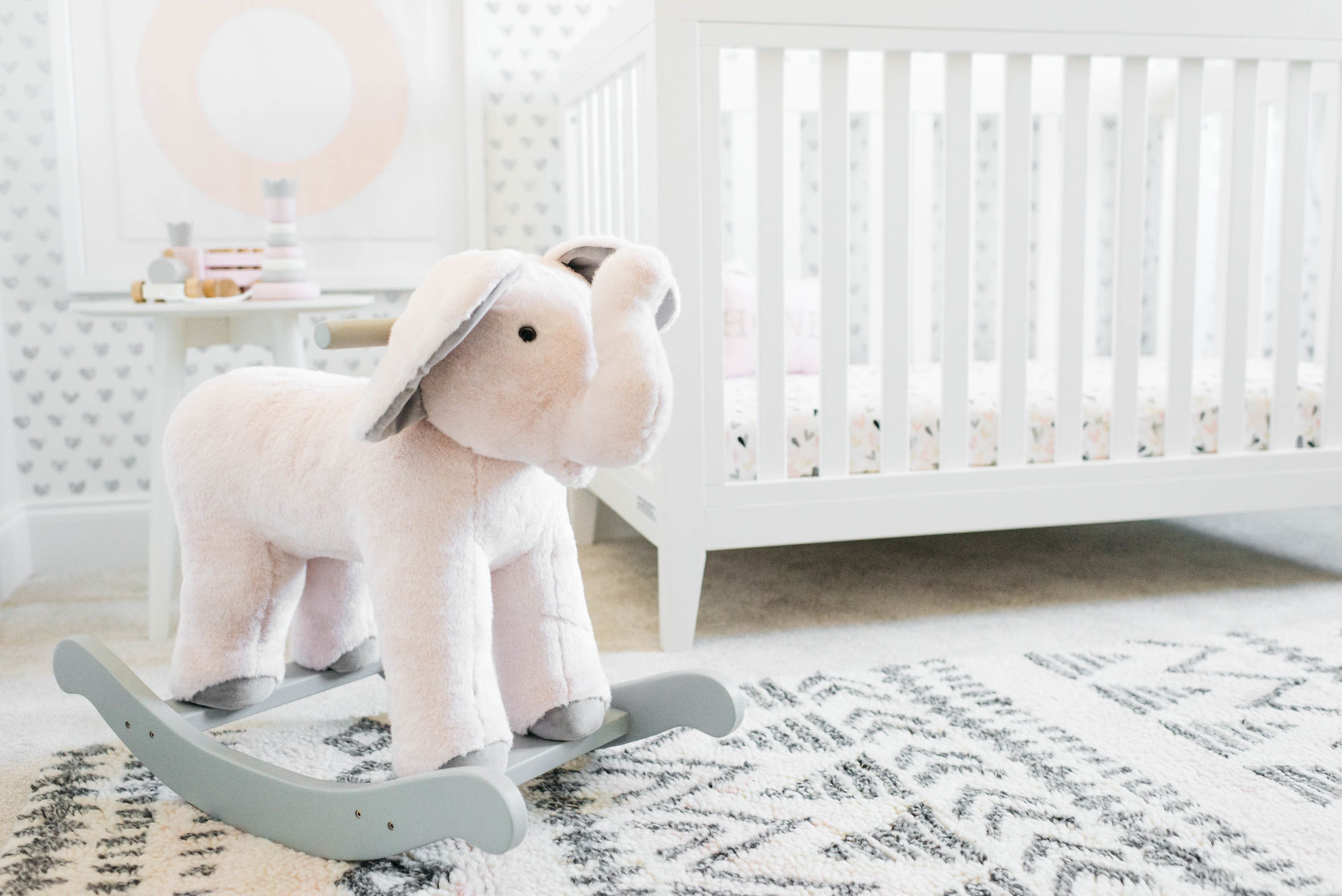 Elephant Rocker in Girl's Pink, White and Gray Nursery - gorgeous decor + crib from @potterybarnkids with @projectnursery styling! #PNpartner