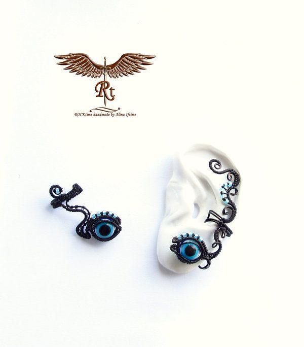 Evil eyes ear cuffs by alina-loreley
