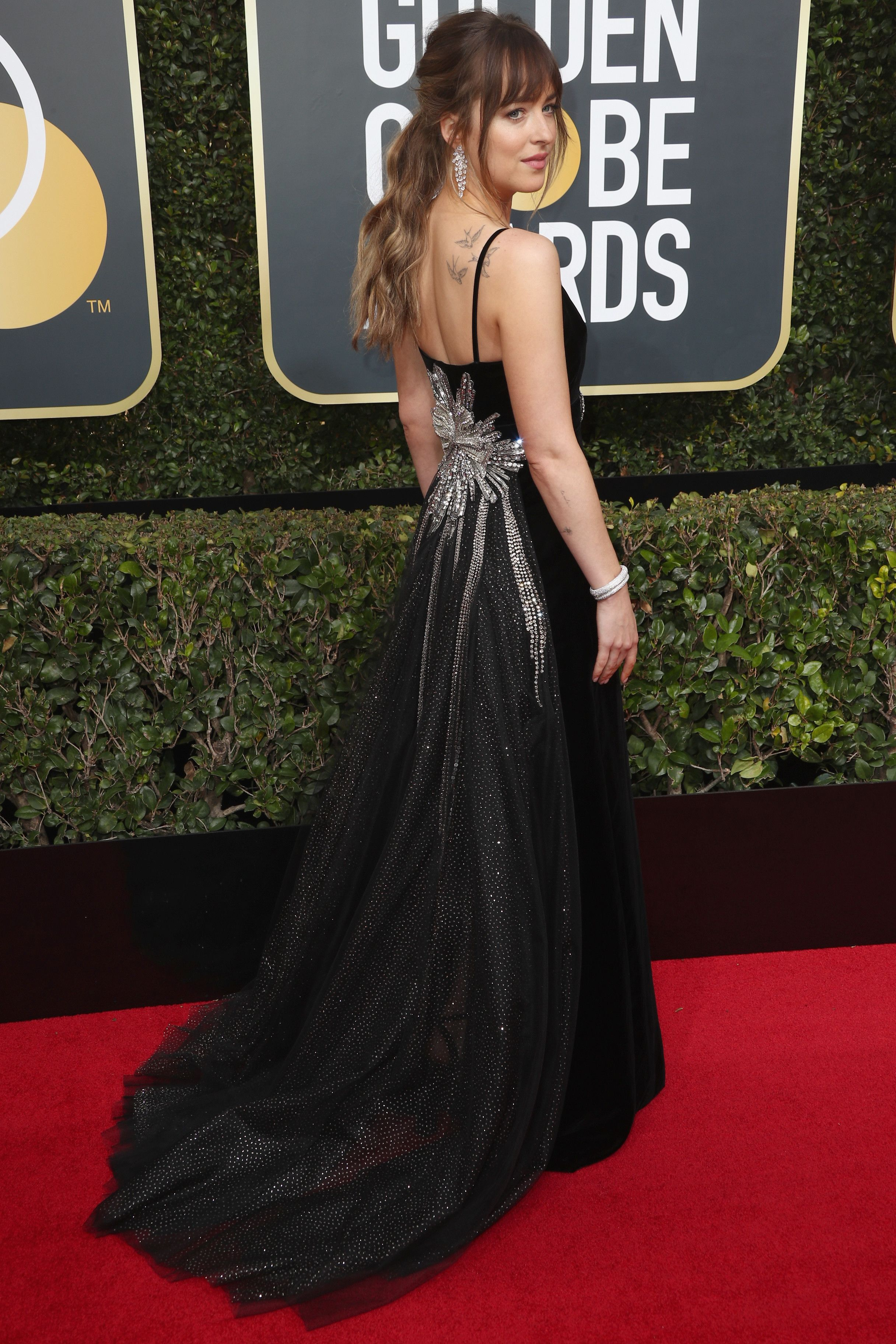 Black dresses ruled the red carpet this year. Dakota Johnson in Gucci -  Every Single Look from the 2018 Golden Globe Awards - Photos af115ea731e6