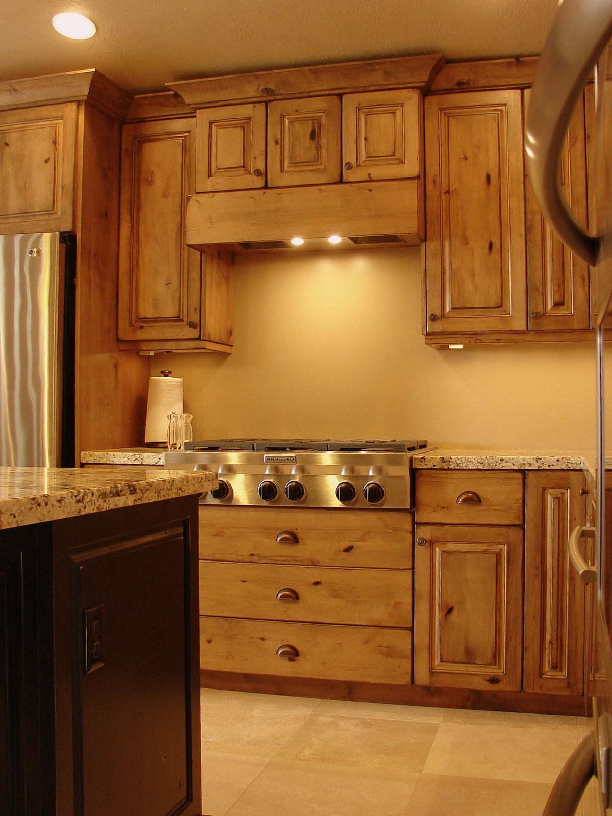 Rustic Kitchen the knotty alder cabinets and natural stone floor