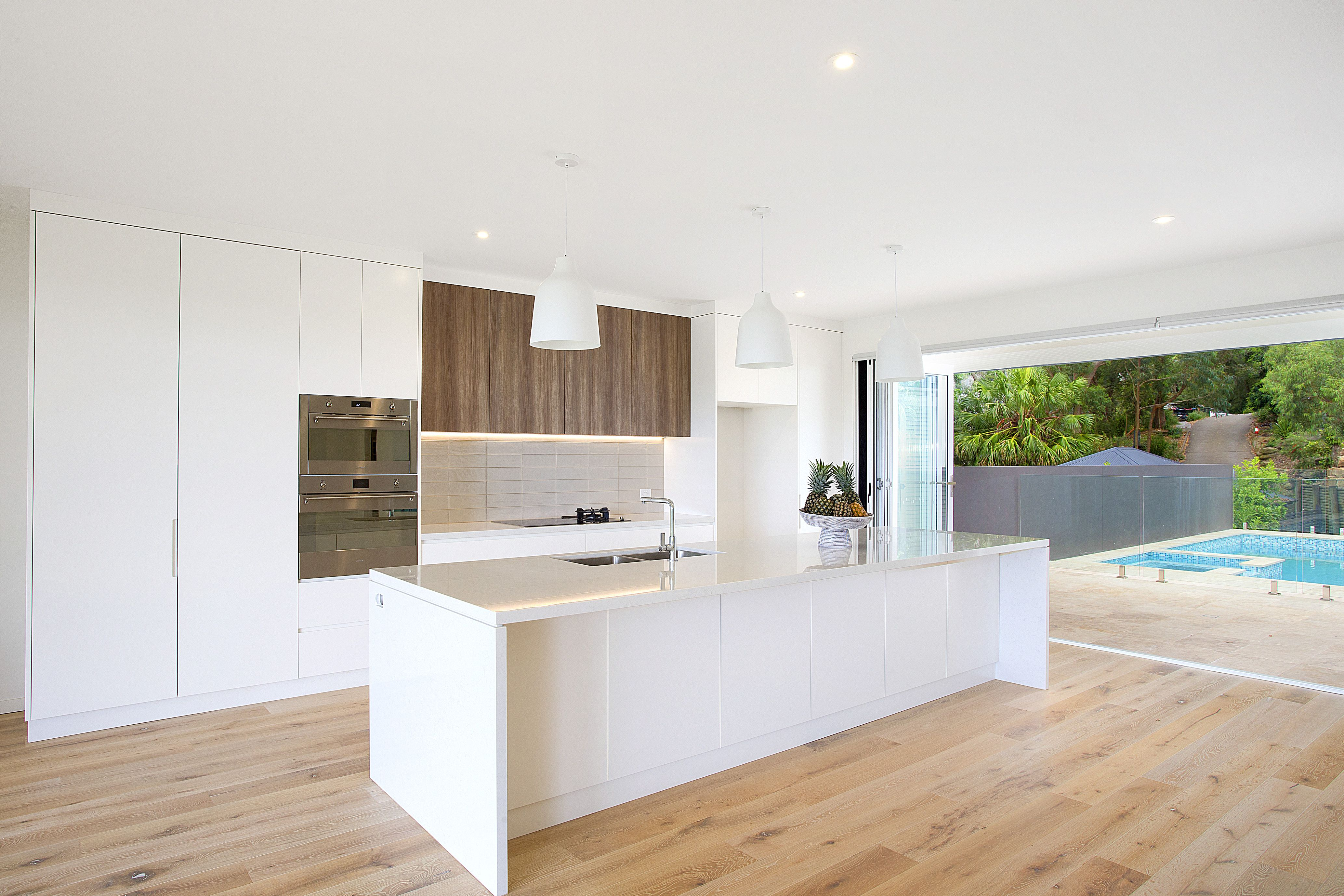 The introduction of more warmth by way of timber furniture will easily enhance this slick starting point.