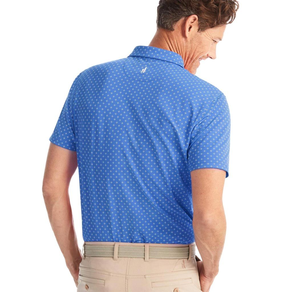 Printed PREP-FORMANCE 4-button polo Printed 93% Polyester / 7% Spandex Stretch Pique Side vents Contrast yoke and inside placket Embroidered logo at center back yoke Moisture-wicking Imported Benefits Looks like a traditional pique polo; feels like a performance polo. Classic old-school 4 button polo, but super lightweight for the hot summer rounds (or just life in the South). Did we mention moisture-wicking?