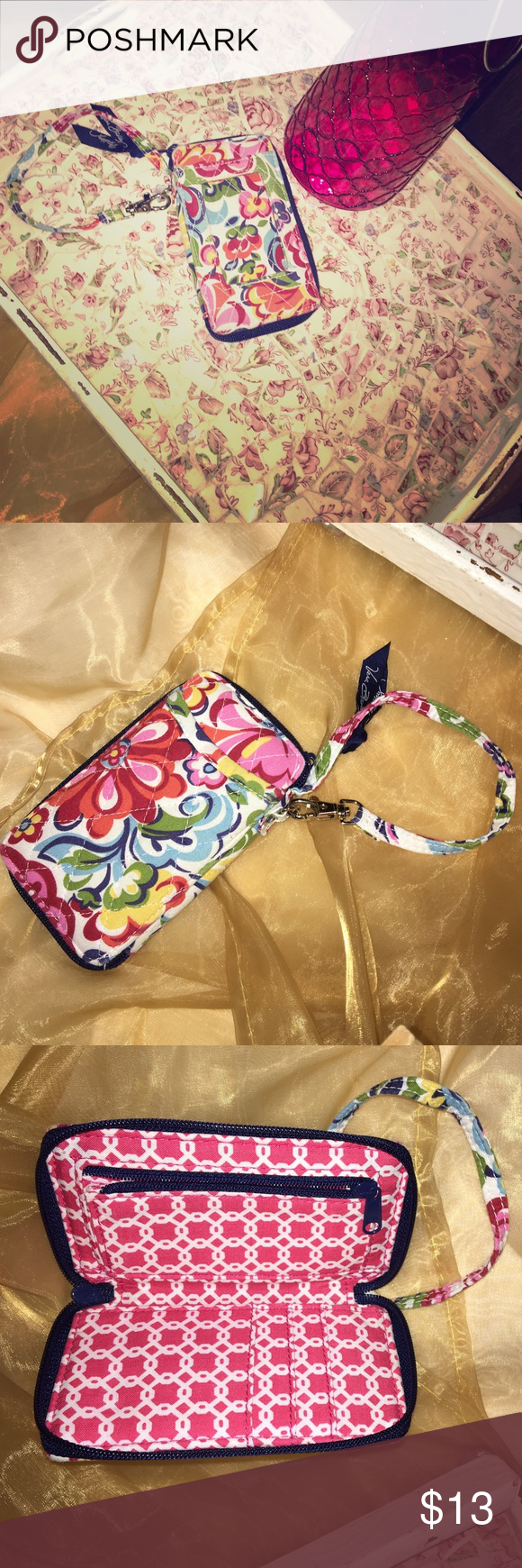 Vera Bradley Wristlet Really cute!! ID holder in the front, pocket in the back, 3 card slots inside with Zip coin slot, and a slot behind that. Smoke free home. 5.5 inches long, 3.5 inches wide. Vera Bradley Bags Clutches & Wristlets