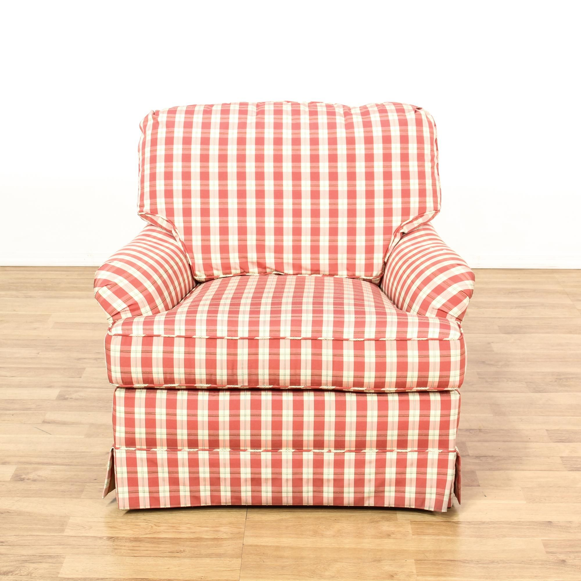 This armchair is upholstered in a red and white plaid gingham