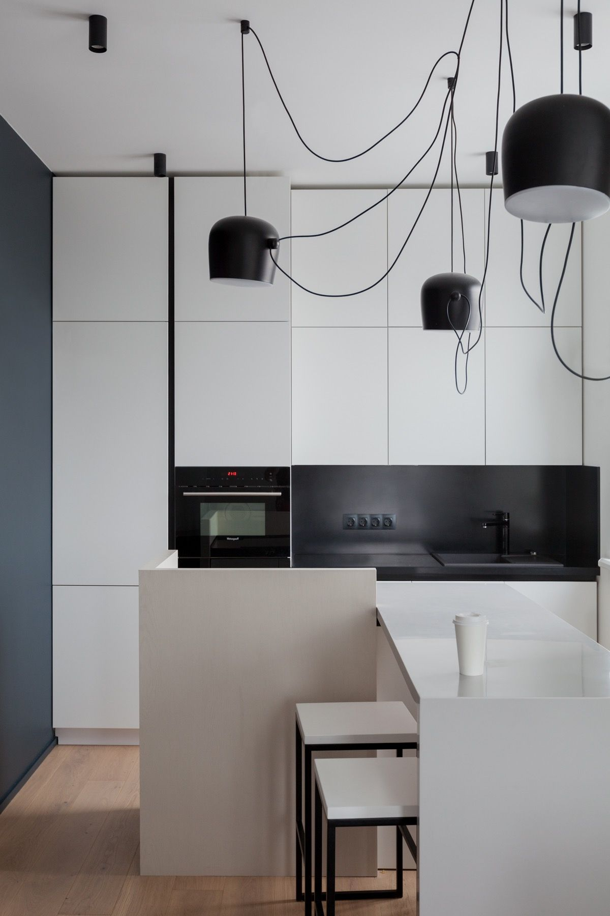 Home interior angles an apartment with a complex geometry  black u white kitchen