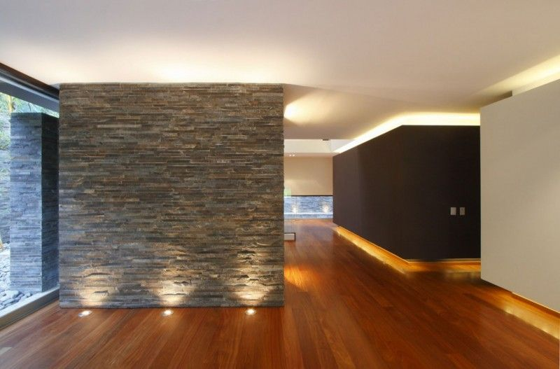 Casa casuarinas by metropolis stone walls white ceiling and architecture interiors aloadofball Images