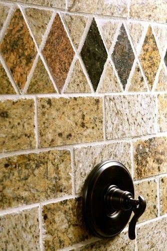 A colorful shower wall of reclaimed granite tiles
