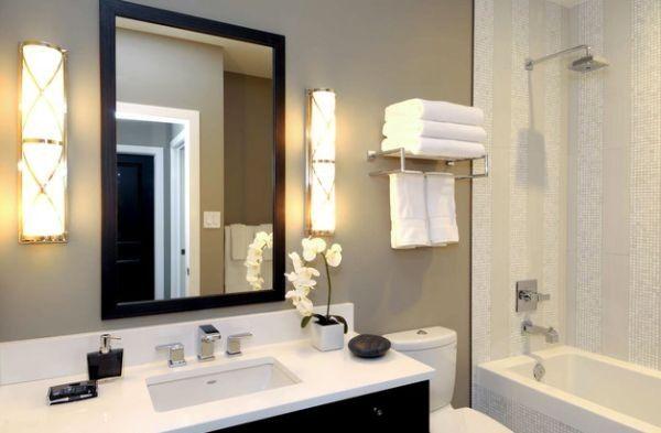 Simple Metal Railing Holds The Towels In An Elegant Fashion - Bathroom towel display arrangement ideas