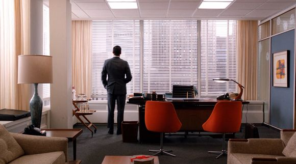 Mad Men Decor don draper in his office. nice orange club-chairs in the front of
