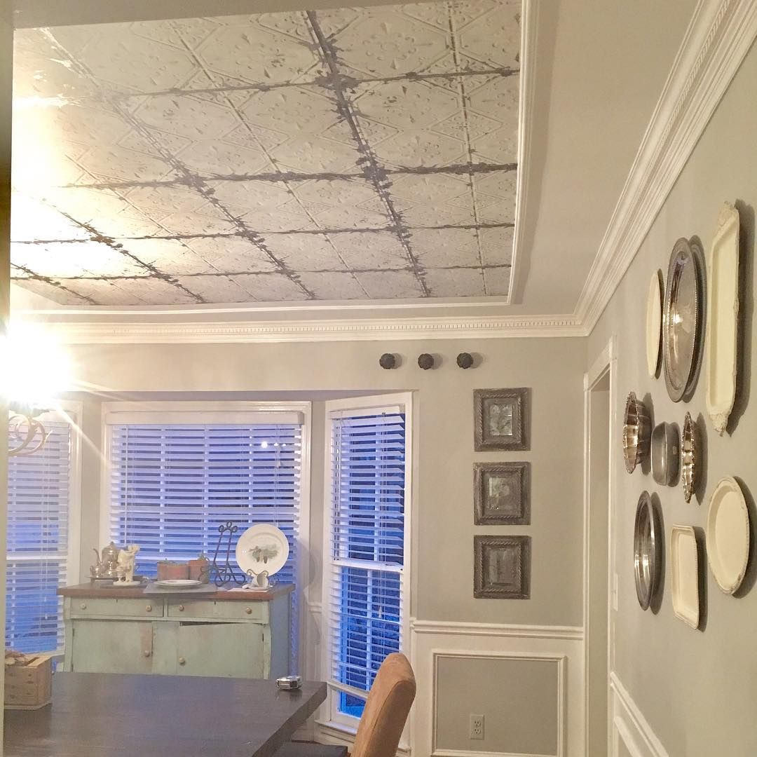 Faux tin tile ceiling using peel and stick temporary