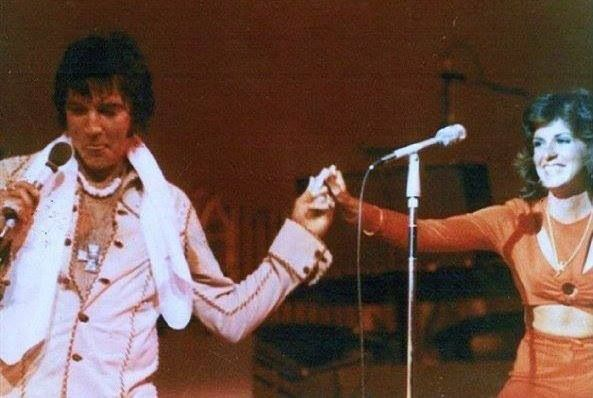 Elvis introducing Kathy Westmoreland on stage - he's wearing the cross  pendant | Elvis presley photos, Elvis in concert, Elvis presley