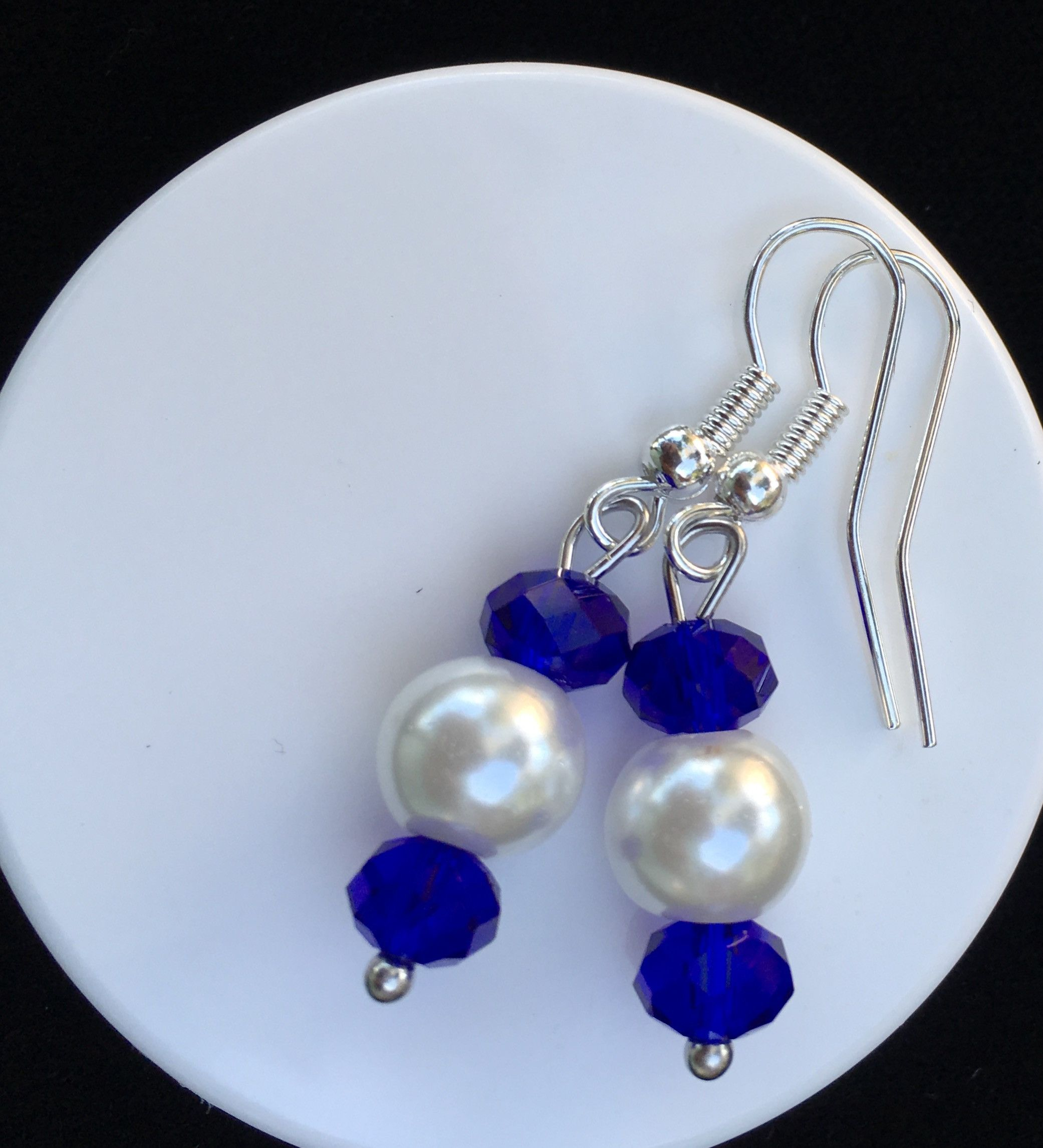 5aa2b2fe5 This set of earrings can be purchased in Gold or Silver, Hook or Post.  Please specify when ordering. They are made with glass (Sapphire) crystals  and white ...