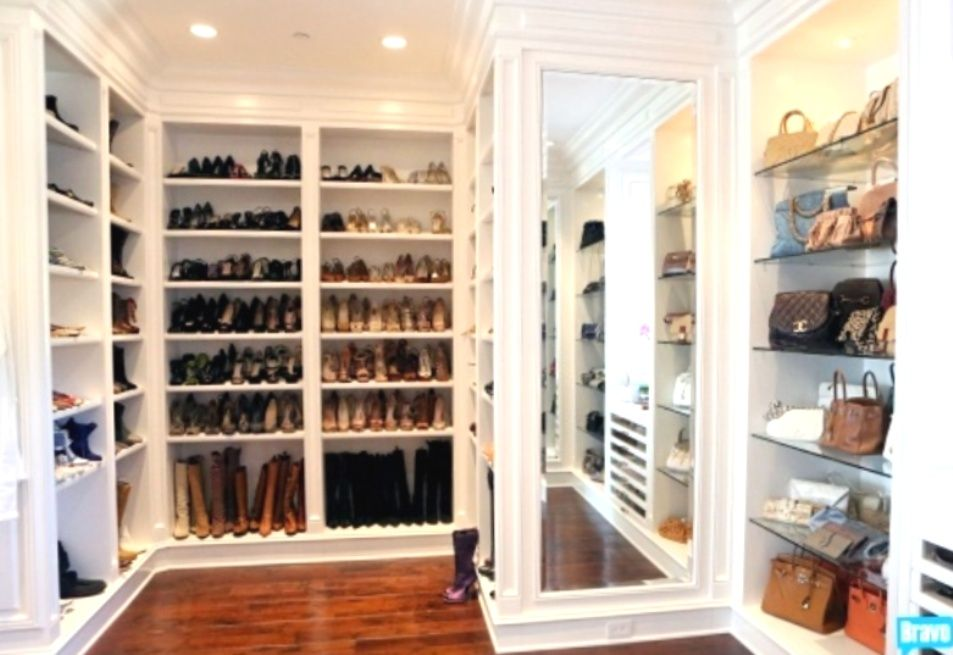 White Shelves, Wood Floors, Yolanda Fosteru0027s Closet   Amazing Walk In Closet  Design With Floor To Ceiling Shelves For Shoes And Boots.