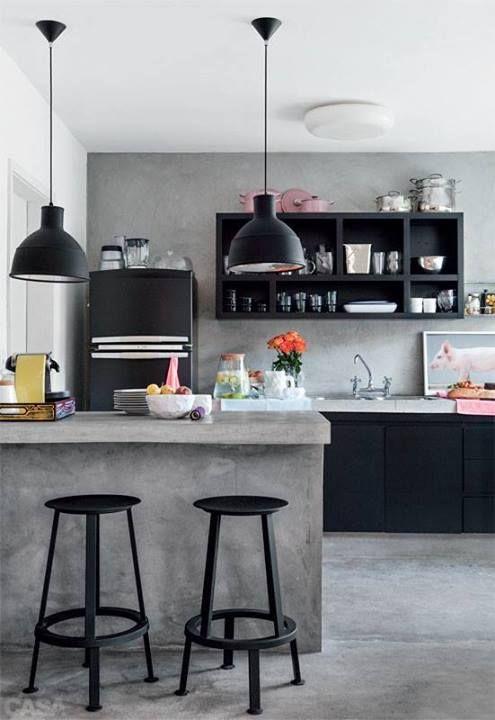Uma cozinha com toque futurista = preto + cimento queimado.