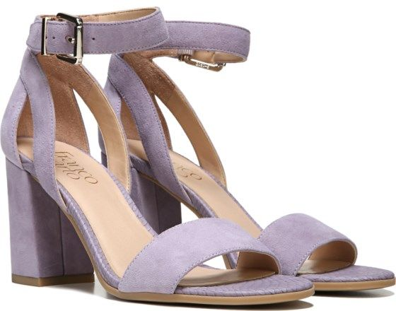 Simplicity is sublime in this effortless, luxurious sandal. Leather, suede, or fabric upper. Open toe, ankle strap with adjustable buckle closure. Side cutout accents. 3 and 1/2 inch covered block heel.