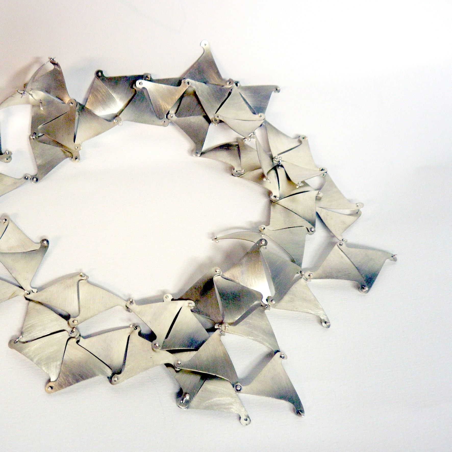 Geometric Jewellery - repeating shapes & an irregular connective ...