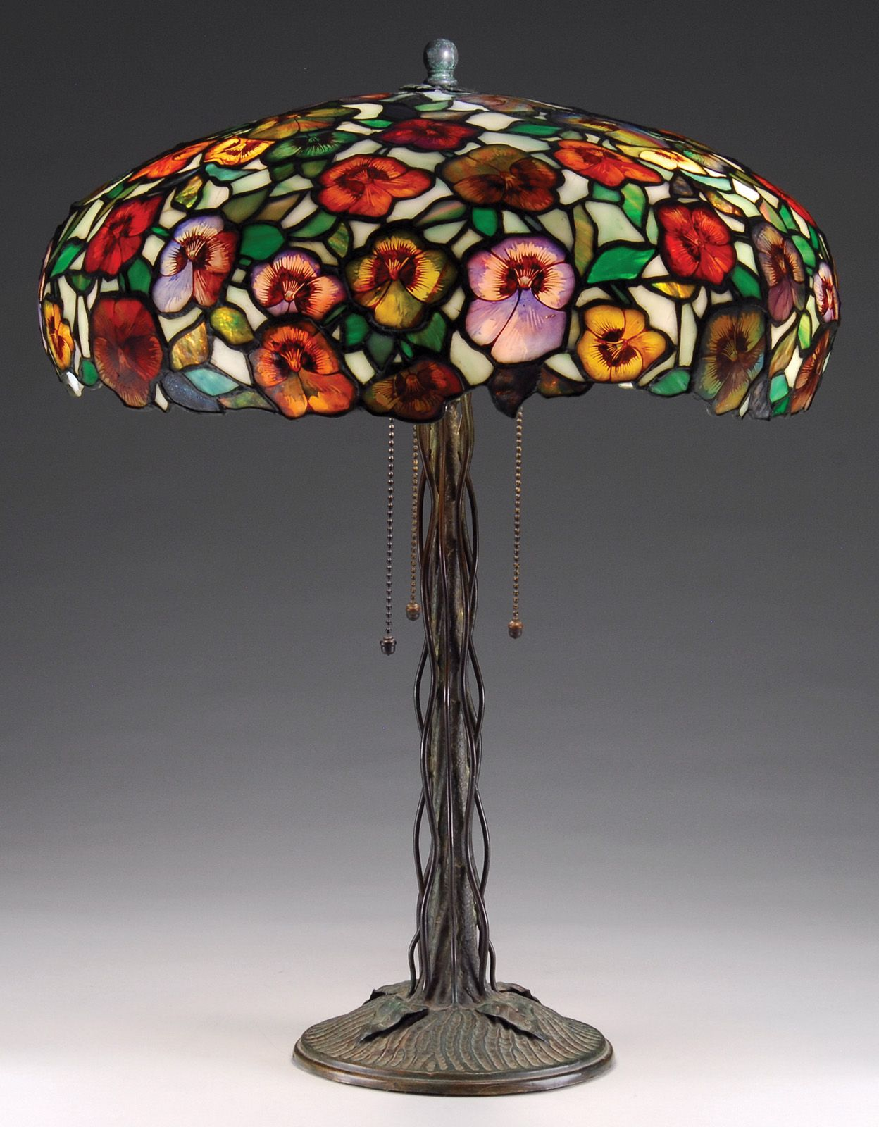 John Morgan & Sons pansy table lamp with a field of multihued flowers on a climbing vine base