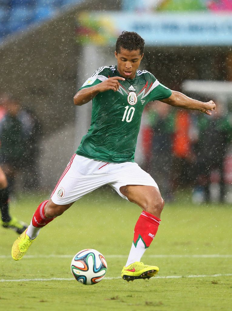 Giovani dos Santos cotnrols the ball during the 2014 FIFA World Cup ...
