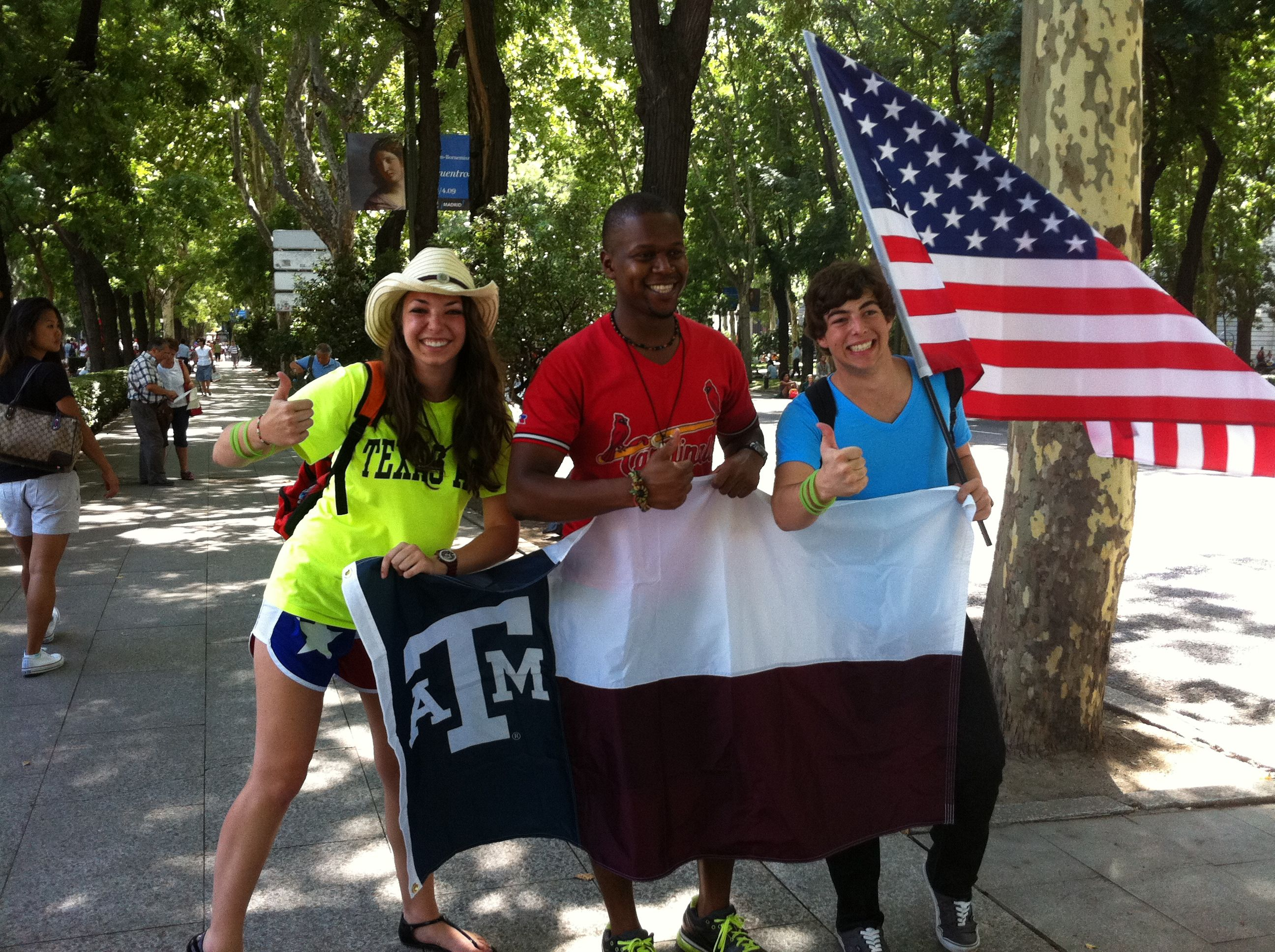 """My brother & I meeting another Aggie at World Youth Day in Madrid, Spain. You are supposed to bring costumes and flags from your home country- we chose TAMU. Also, we may or may not have told foreigners that is was the Texas flag and that all Texans say """"Howdy, gig 'em!""""  ;) This was one of several Aggies that we ran into."""