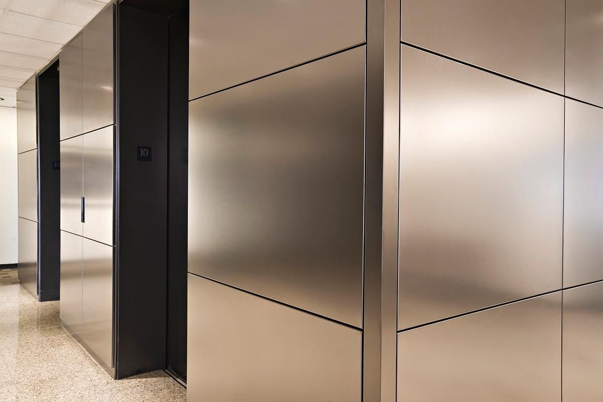 Levele Wall Cladding System With Float Panels And Custom Corner Detail In Fused Nickel Silver With Linen Metal Wall Panel Steel Cladding Stainless Steel Panels