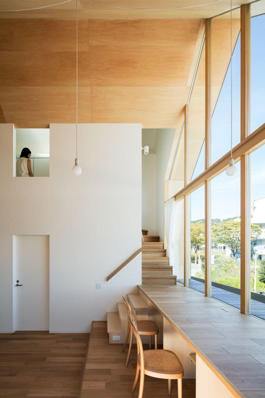 Photo of hiroto kawaguchi+kohei yukawa's wood-clad newtown house overlooks the picturesque japanese landscape