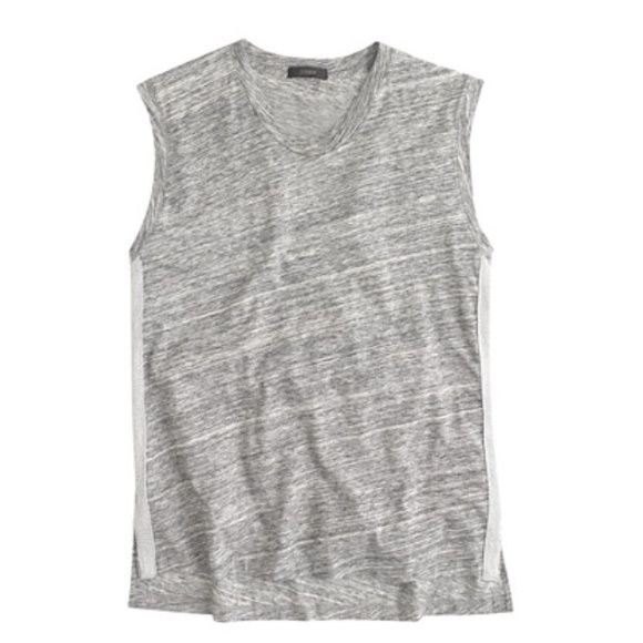 "J. Crew metallic side stripe tank With metallic side stripes, your favorite tank top is now appropriate to wear pretty much everywhere. Cotton. Slightly loose fit- runs a bit larger  Body length: 26"".  Color is heather flannel.  A bit darker grey than the first photo depicts.  2nd photo is for fit purposes.   Photos from J.Crew.com J. Crew Tops Tank Tops"