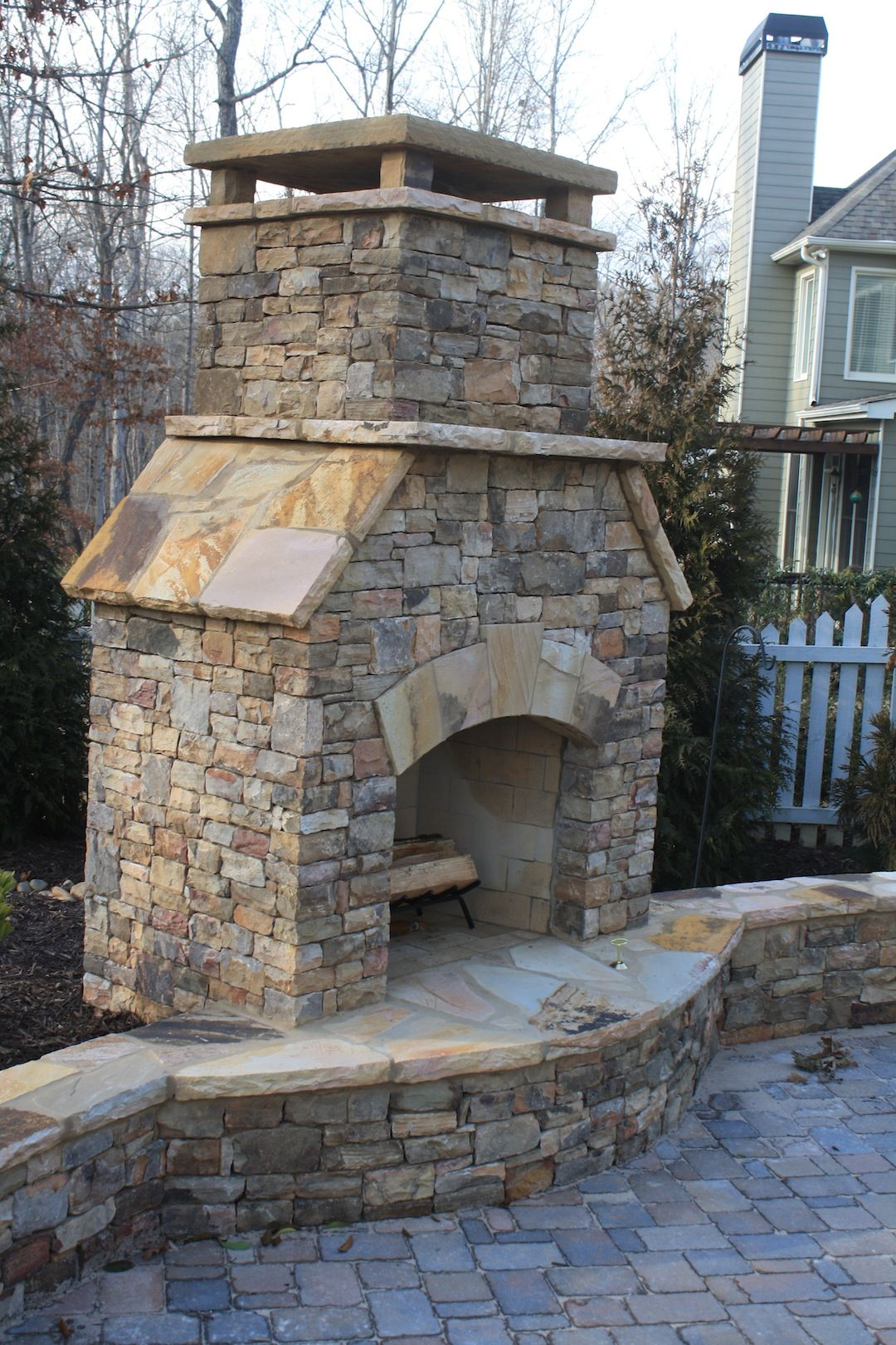 outdoor stacked stone fireplace with