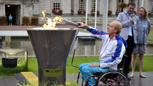 The ceremonial cauldron is lit in Wales