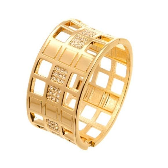 Gold & Austrian Crystal Geometric Hinged Bangle Bold and beautiful, this bangle makes a stunning style statement. Crafted with gleaming gold plating and shimmering crystal accents, this eye-catching accessory is a fashion-forward finishing touch to any ensemble. suevelle Jewelry