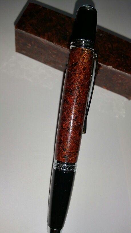 Wood shavings (purple heart, paduka, black walnut) cast in a
