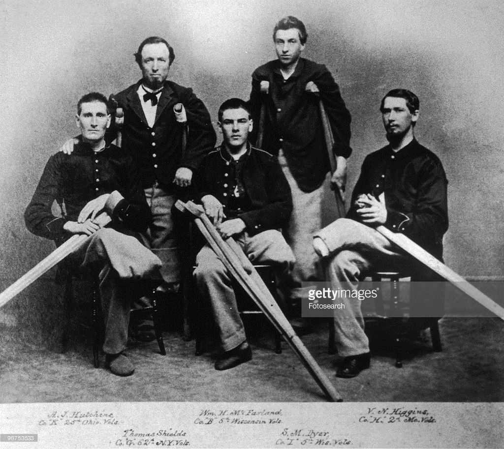 A portrait of five Union soldiers at the Armory Square Hospital, Washington DC, who have all lost limbs during the American Civil War: 'A.J. Hutchins, Co. 'K' 24th Ohio. Vols.; Thomas Shields, Co. 'G' 62d N.Y. Vols.; Wm. H. McFarland, Co. 'B' 5th Wisconsin Vols.; S.M. Dyer, Co. 'I' 5th Wis. Vols.; V.N. Higgins, Co. 'H' 2d Me. Vols.' Washington DC, USA, circa 1870. (Photo by Fotosearch/Getty Images).