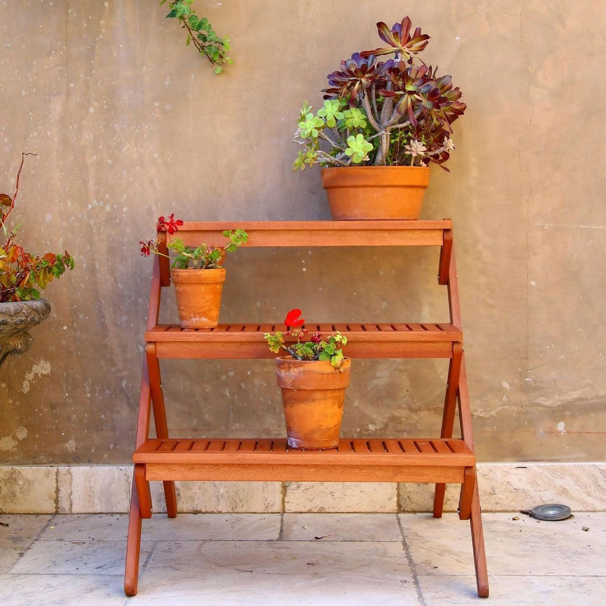 Find A Home For Your Potted Plants With This Wooden Outdoor Three Tier  Plant Stand