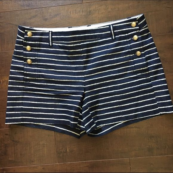 Navy blue and white Kenar shorts with gold buttons Navy blue and white Kenar shorts with gold buttons. The buttons have anchors on them. The white stripes look like rope. 4 inch inseam. The buttons in the side open for putting on. Kenar Shorts