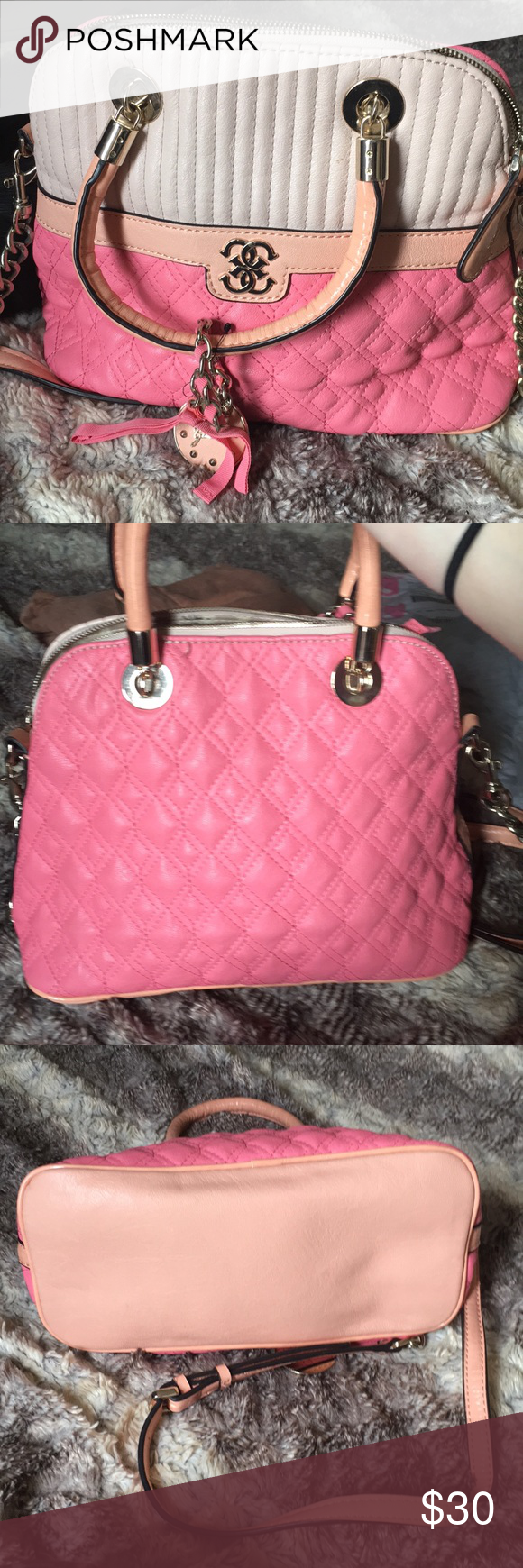 b563b9bdf21 Guess purse Very cute and girly guess purse. Overall great, like new  condition with only a couple loose strings. Baby pink peach watermelon  colors Guess ...