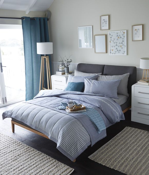 Home Bedroom Inspiration Ideas. Scandinavian inspired bedroom with striped blue bedding and pillows