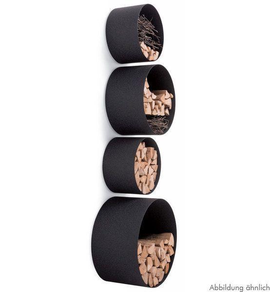 Kreisrunde Röhren bilden die Grundlage für dieses originelle Aufbewahrungssystem. Hier finden Feuerholz, Bücher und Wohnaccessoires bequem Platz. D...: