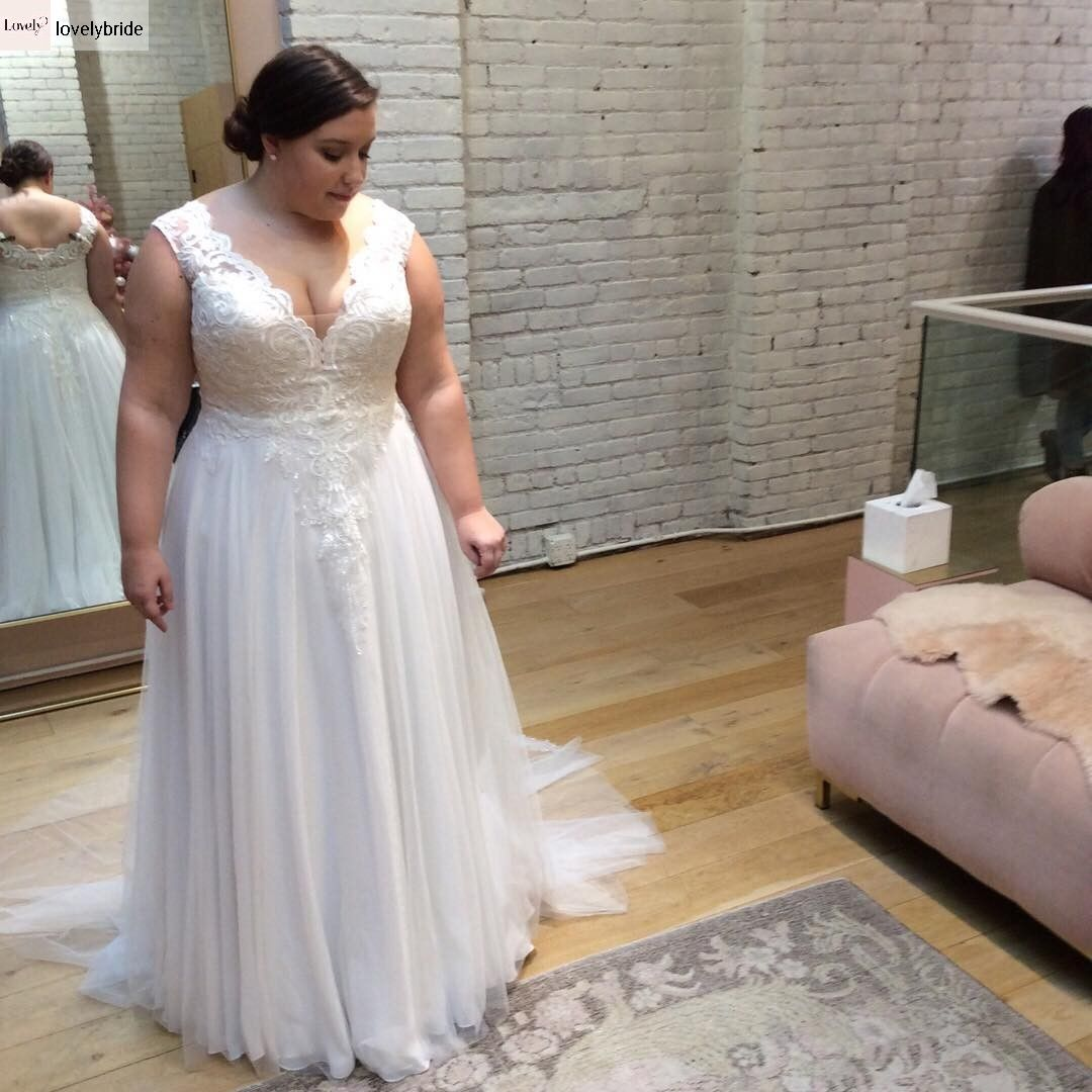 b608604ca8e9 Plus size wedding gown with interior corset and gentle lace. Tracie. Studio  Levana