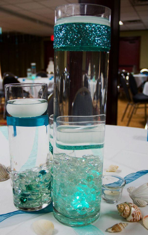 wrapping a cylinder vase with differing widths/styles of ribbon is an easy and inexpensive way to infuse pops of color in to your table decor!    Photo Courtesy of Sheena Stovall Photography