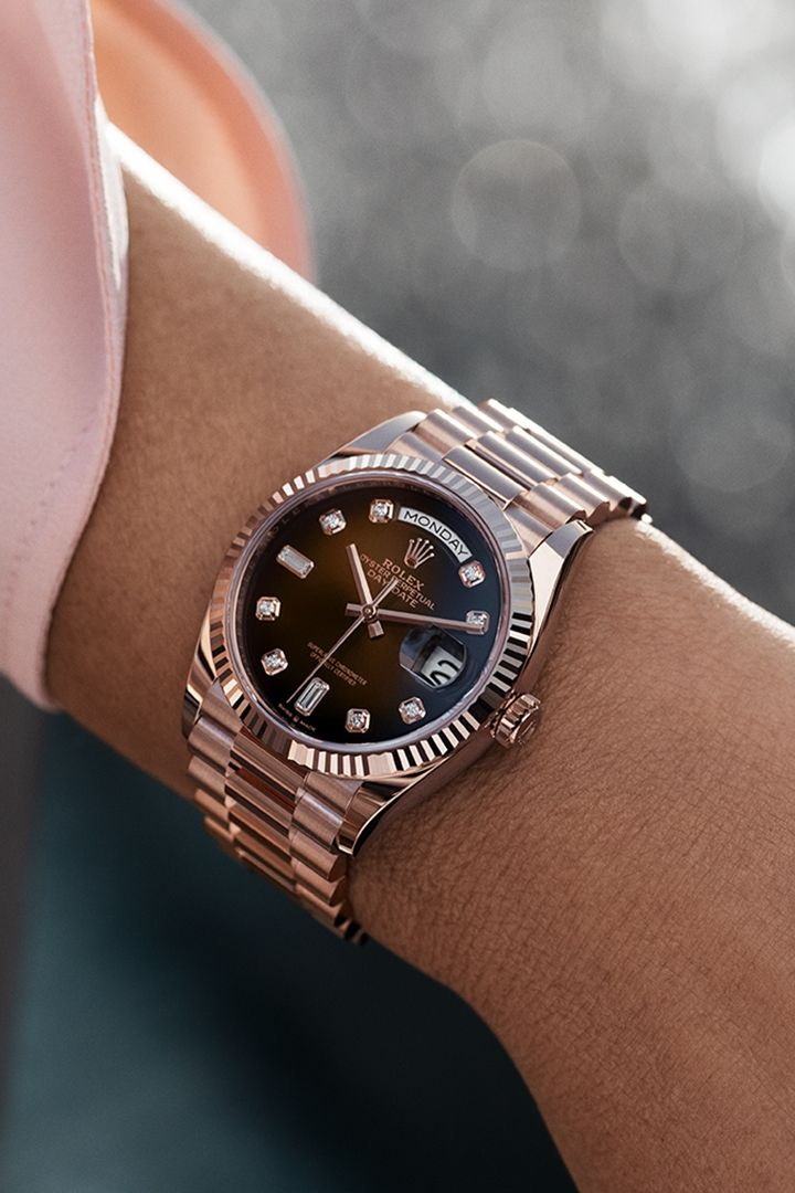 Inspiration for the season. The Rolex Day-Date 36 in 18 ct Everose gold, 36 mm case, brown ombré dial set with diamonds, President bracelet. #Festive #Rolex