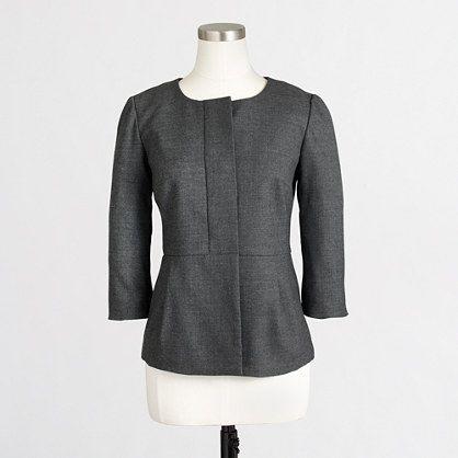 <ul><li>Wool/poly/viscose with a hint of stretch.</li><li>Hits at hip.</li><li>Three-button closure (two hidden).</li><li>Elbow sleeves with vents.</li><li>Lined.</li><li>Dry clean.</li><li>Import.</li></ul>