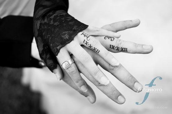 This would hurt like bell but I really like the idea of the wedding date on the ring finger like this :)