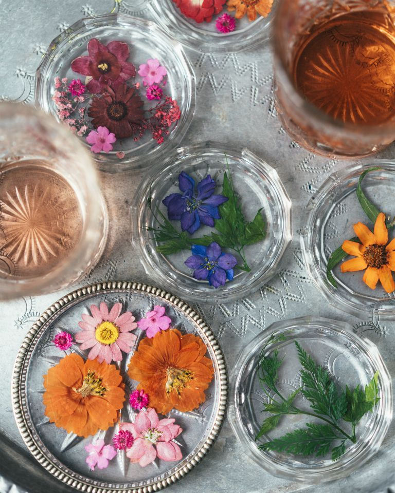 Make these beautiful pressed flower glass coasters in 3 simple steps is part of Pressed flower crafts - Using pressed flower craft   the process of drying flower petals and leaves whilst preserving their beauty   you can create a lasting arrangement that will be the perfect finishing touch to your table decorations